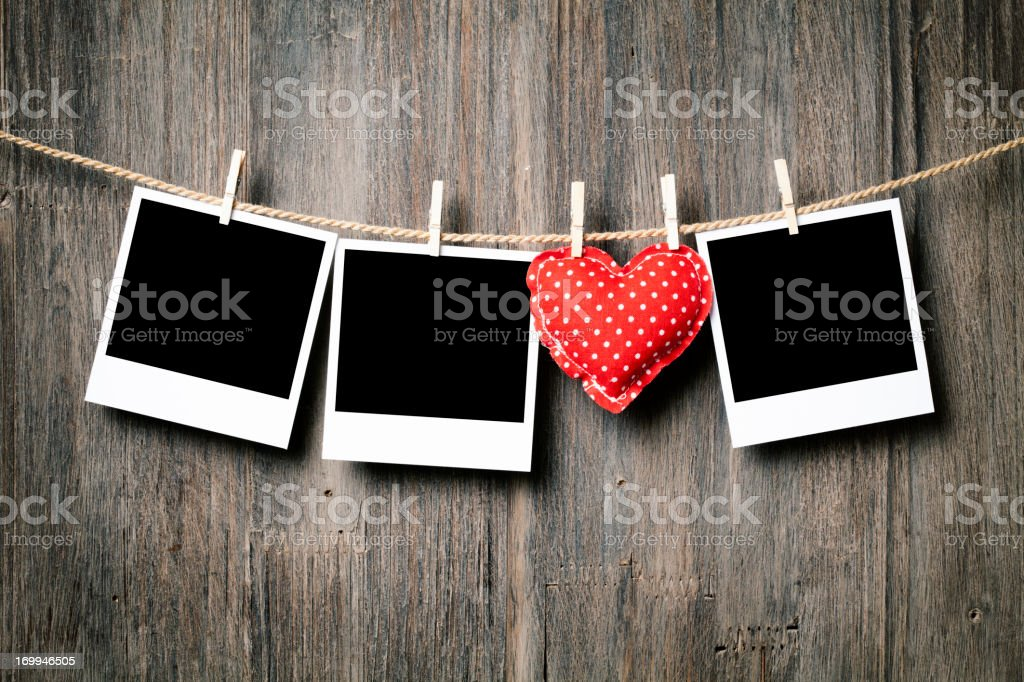 Polaroids and Heart on Clothesline stock photo