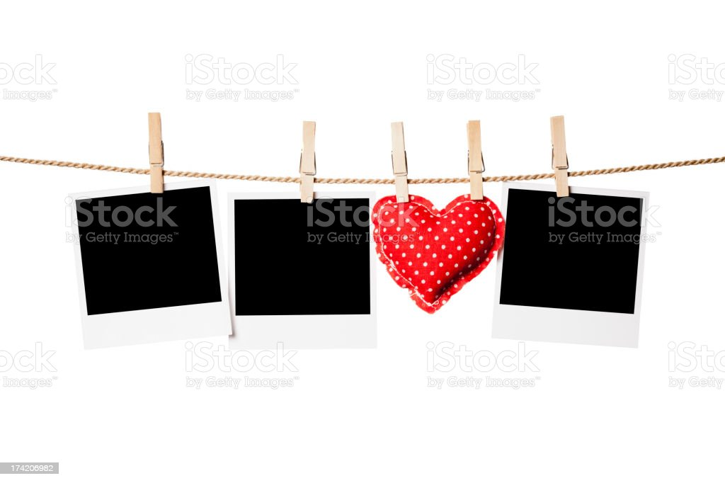 Polaroids and Heart on Clothesline royalty-free stock photo