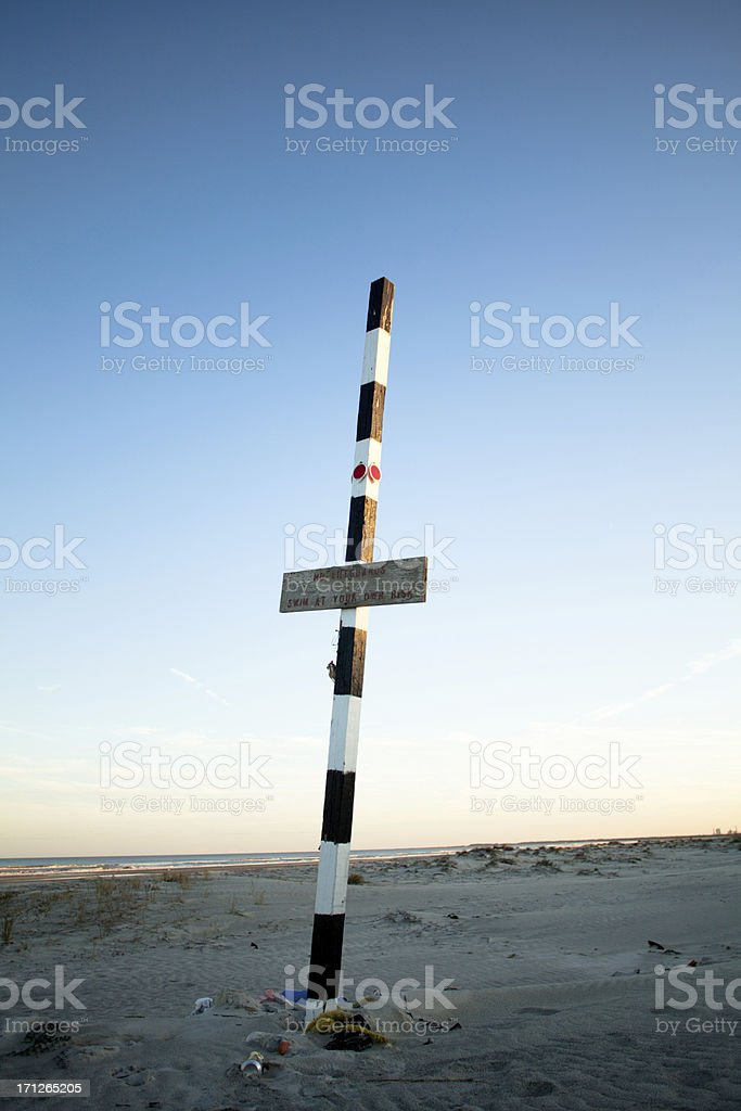 Pole and sign in sand on cumberland island beach royalty-free stock photo