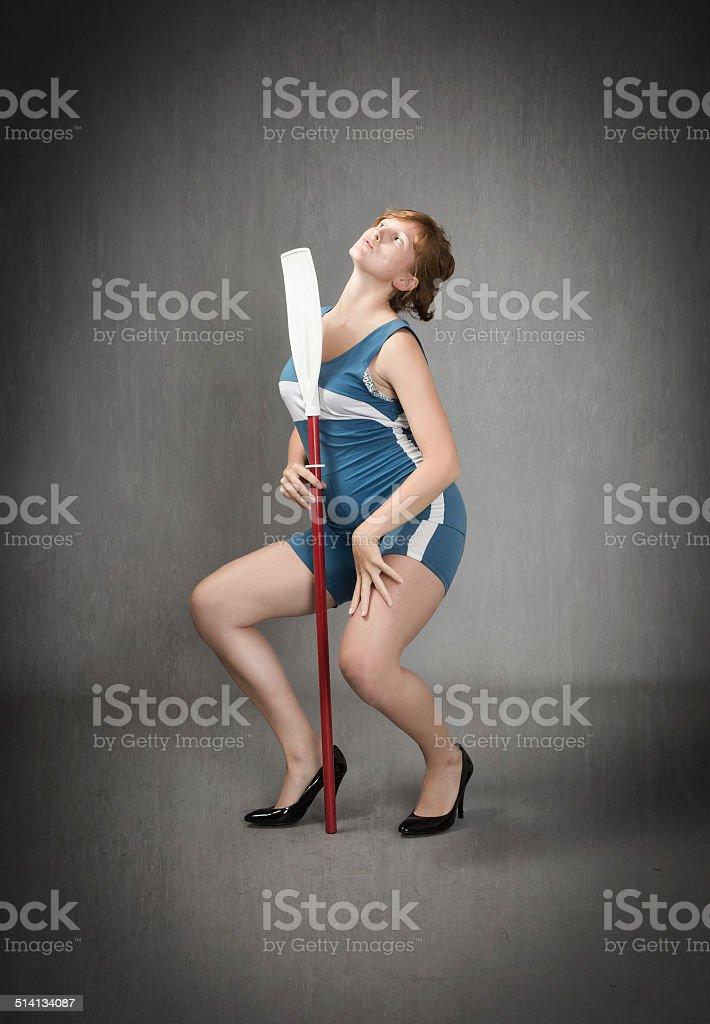 pole dancer with an oar on hand stock photo