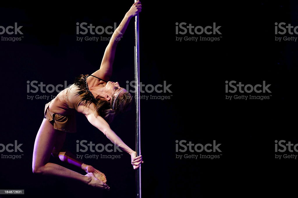 Pole dancing figure - twisted grip mount stock photo