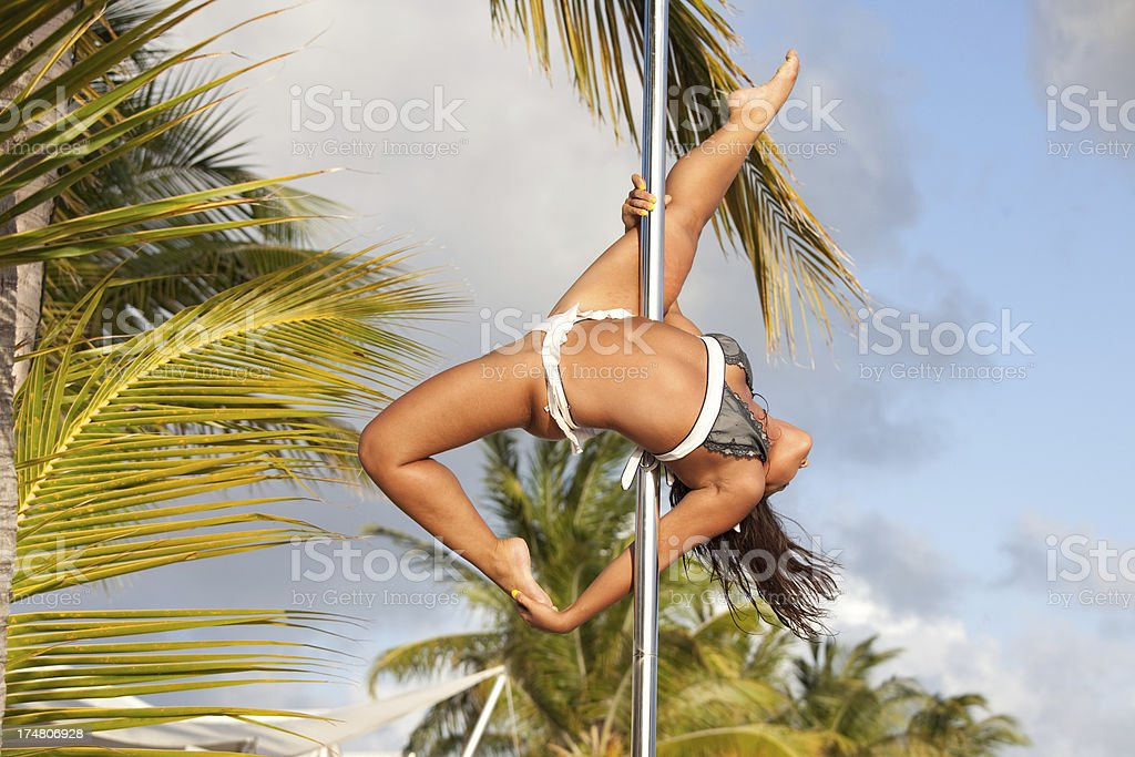 Pole dancing on the beach royalty-free stock photo