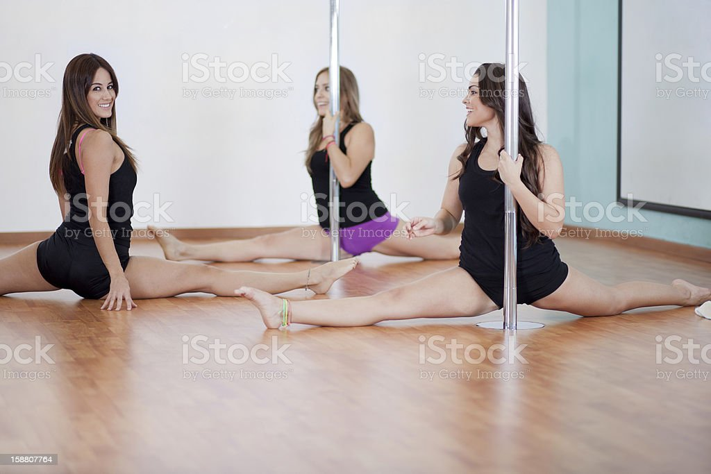 Pole fitness instructor and students during class stock photo