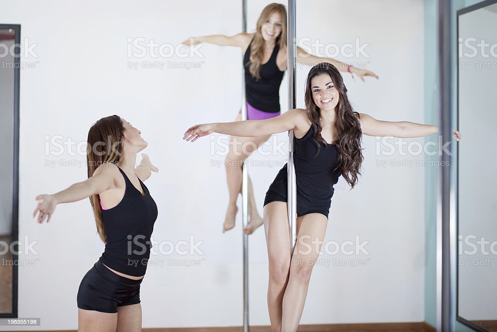 Pole fitness students and instructor in class royalty-free stock photo