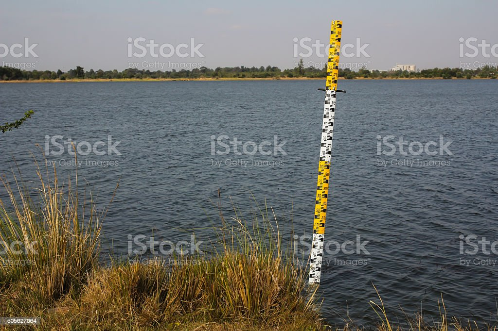 Pole measuring water levels in dams stock photo