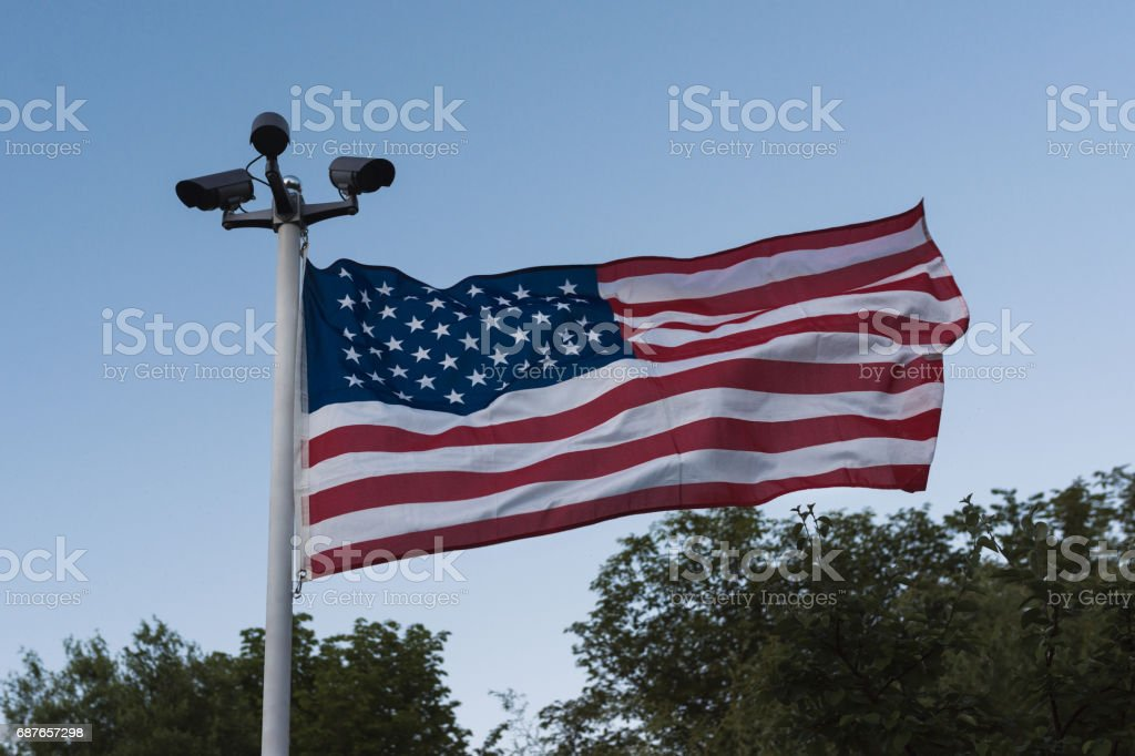 Pole with three security cameras and USA flag stock photo