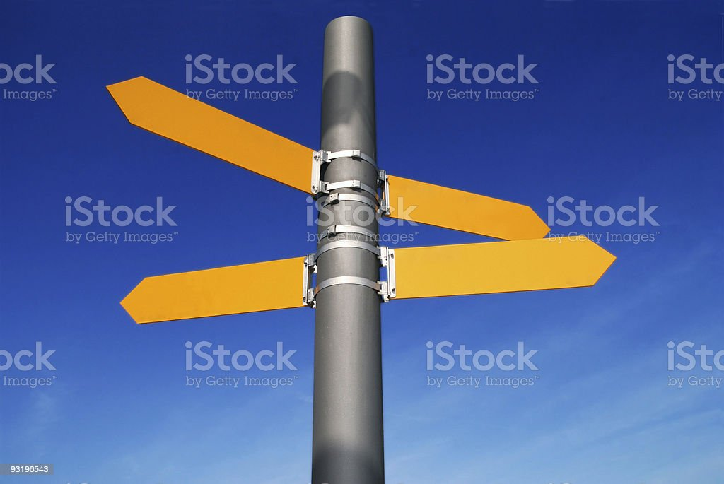Pole with yellow, blank directional signs going several ways royalty-free stock photo