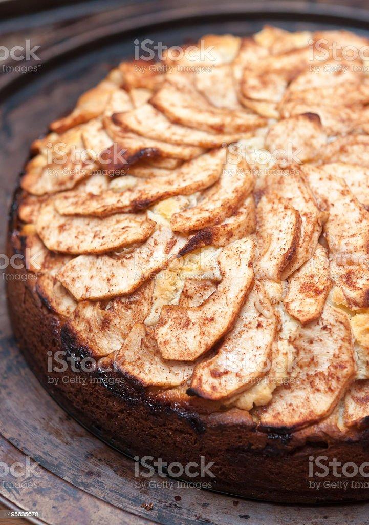 Polenta apple cake on rustic baking sheet stock photo