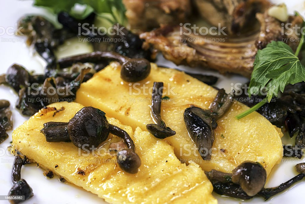 Polenta, baked rabbit and mushrooms royalty-free stock photo