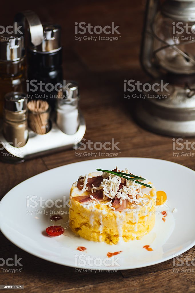 Polenta on a wooden table royalty-free stock photo