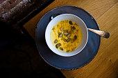 Polenta porridge bowl with pumpkin seeds and honey