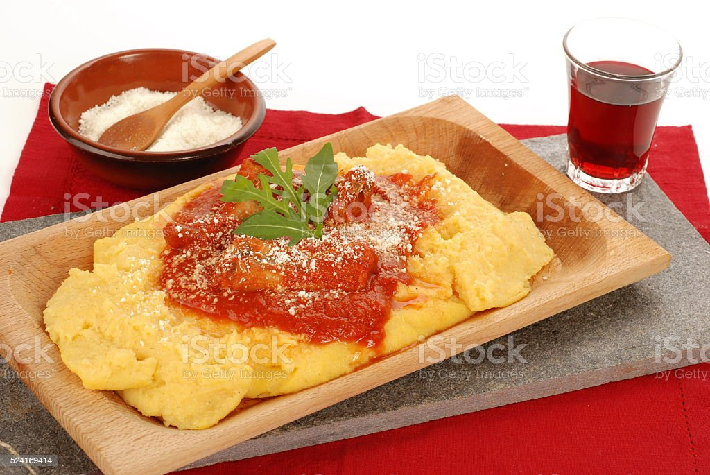 Polenta with meat and red wine stock photo