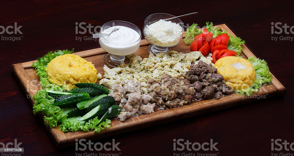Polenta with meat and vegetables stock photo