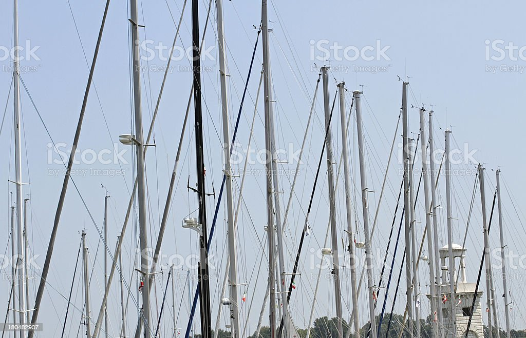 Poles and masts masters of luxury yachts royalty-free stock photo