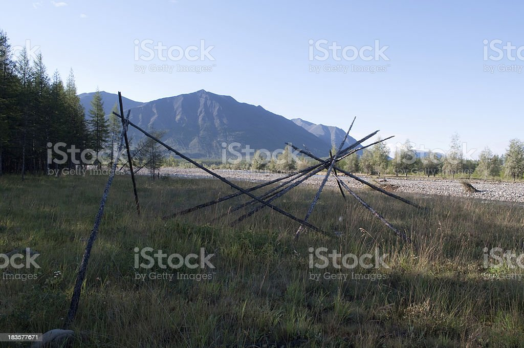 Poles of an abandoned camp royalty-free stock photo