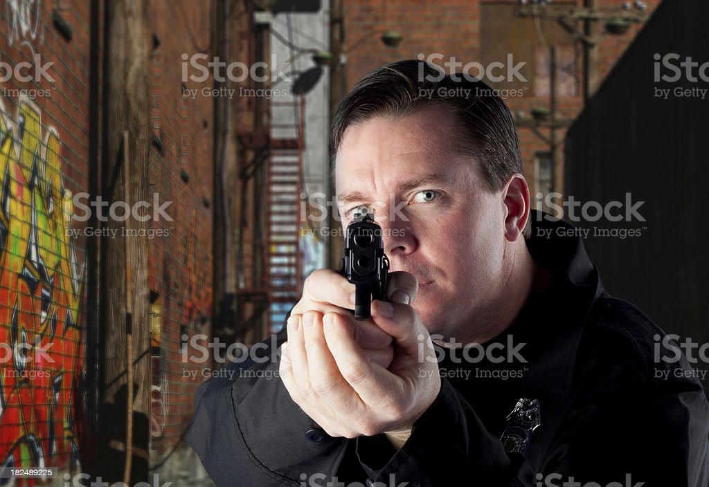 Police Aiming a Pistol royalty-free stock photo