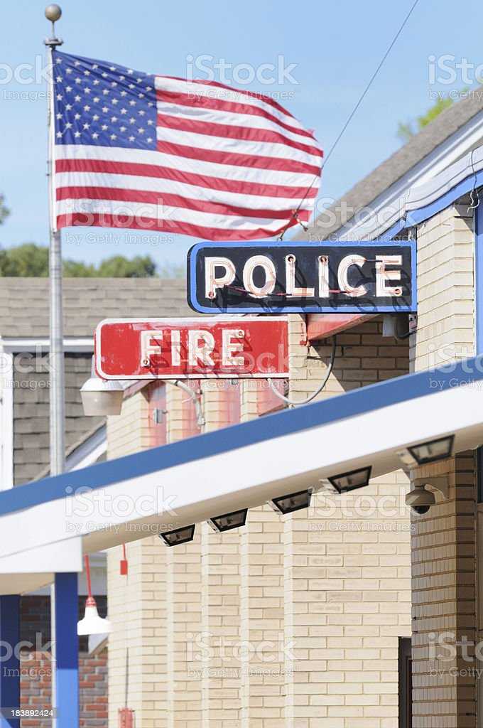 Police and fire station signs with flag royalty-free stock photo