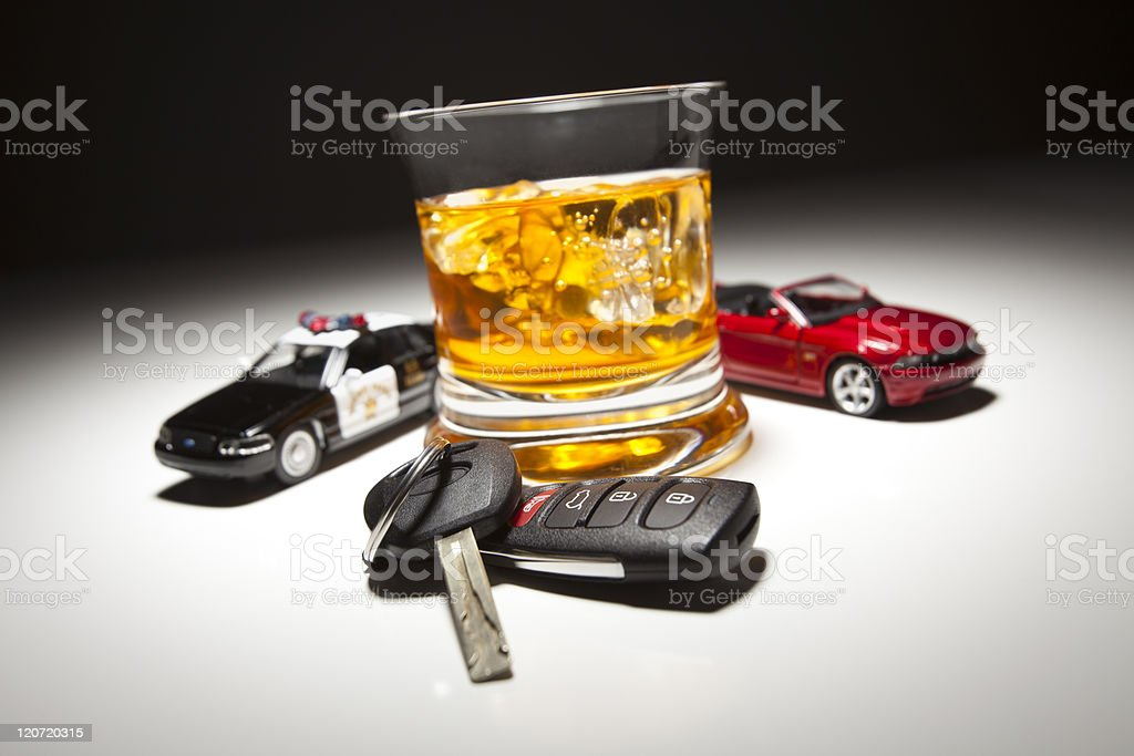 Police and Sports Car Next to Alcoholic Drink with Key stock photo