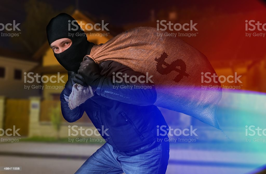 Police arrested thief with full bag of money at night stock photo