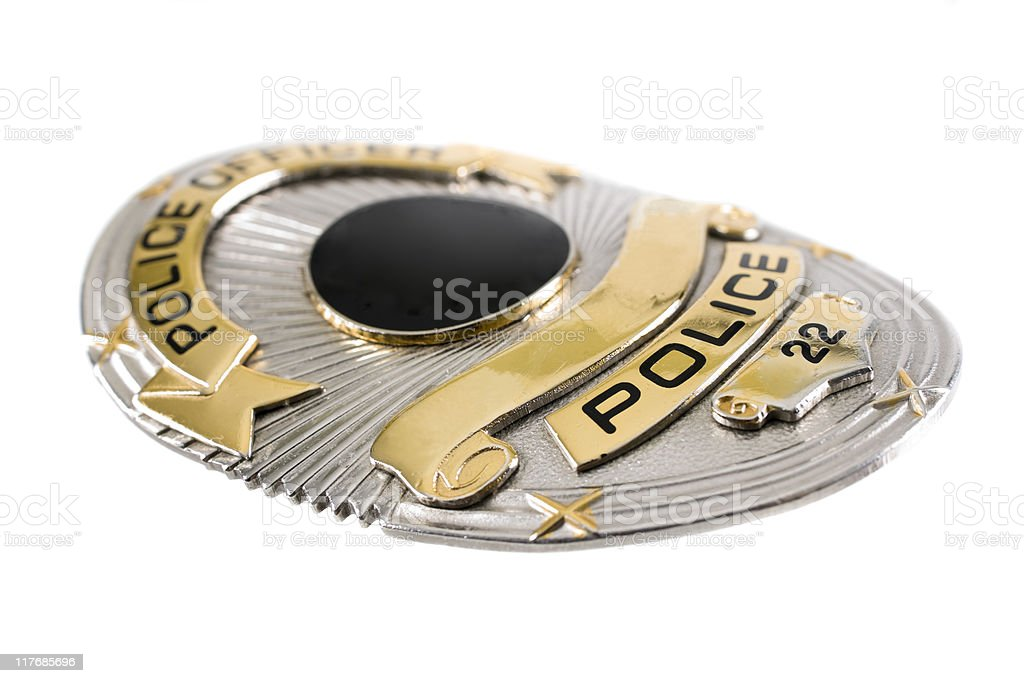 A police badge against a white background stock photo