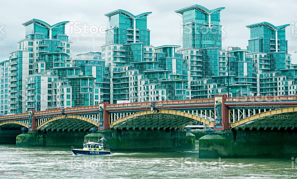 Police boat on Thames River in London England stock photo
