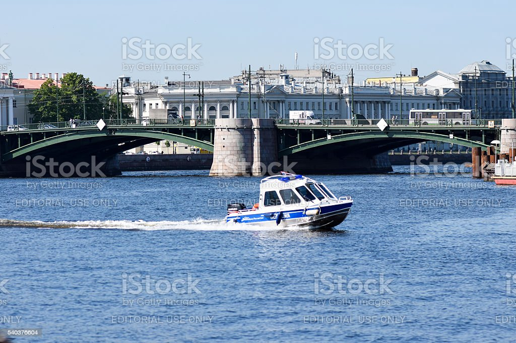 Police boat speeding on the river Neva in St. Petersburg stock photo