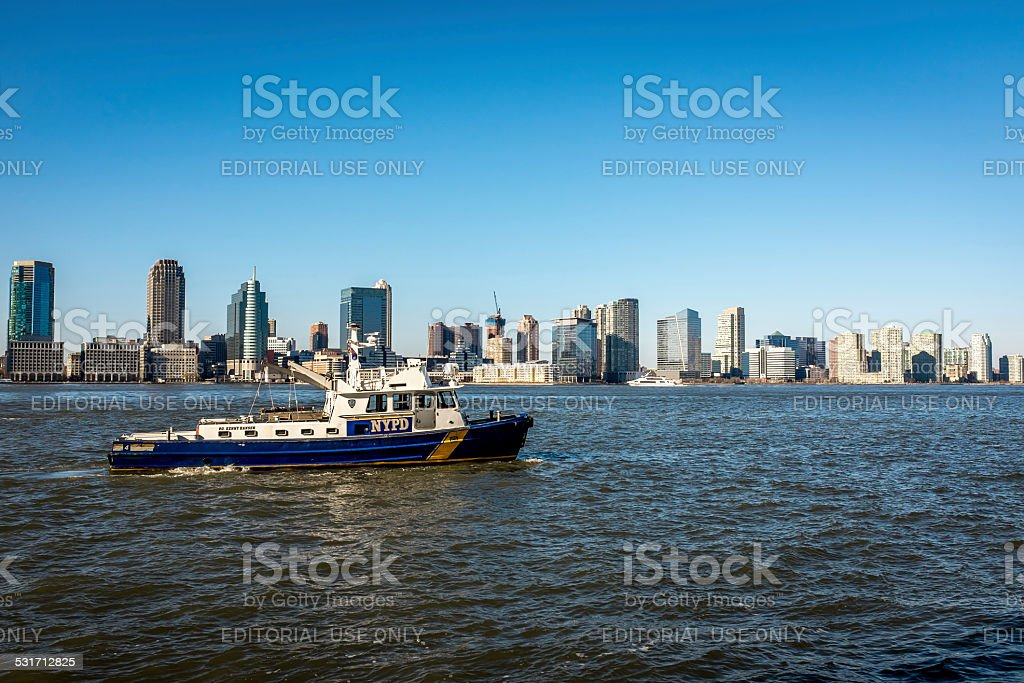 NYPD Police Boat with New Jersey Skyline stock photo