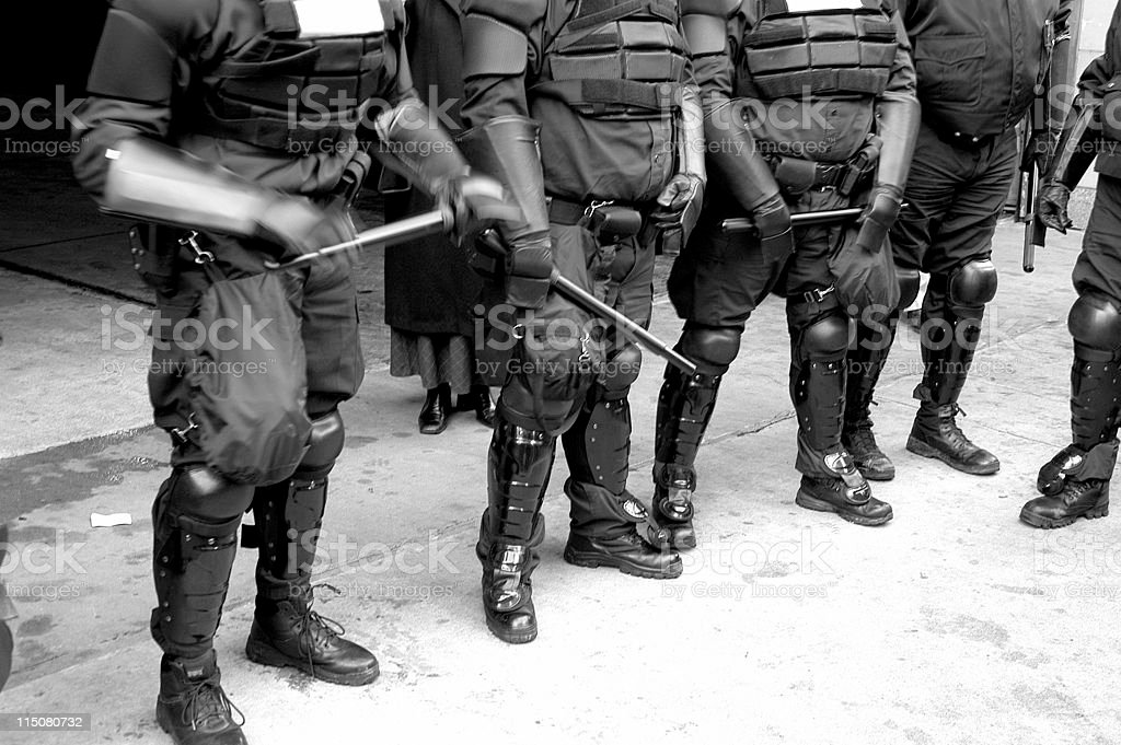 Police bodies in riot gear stock photo
