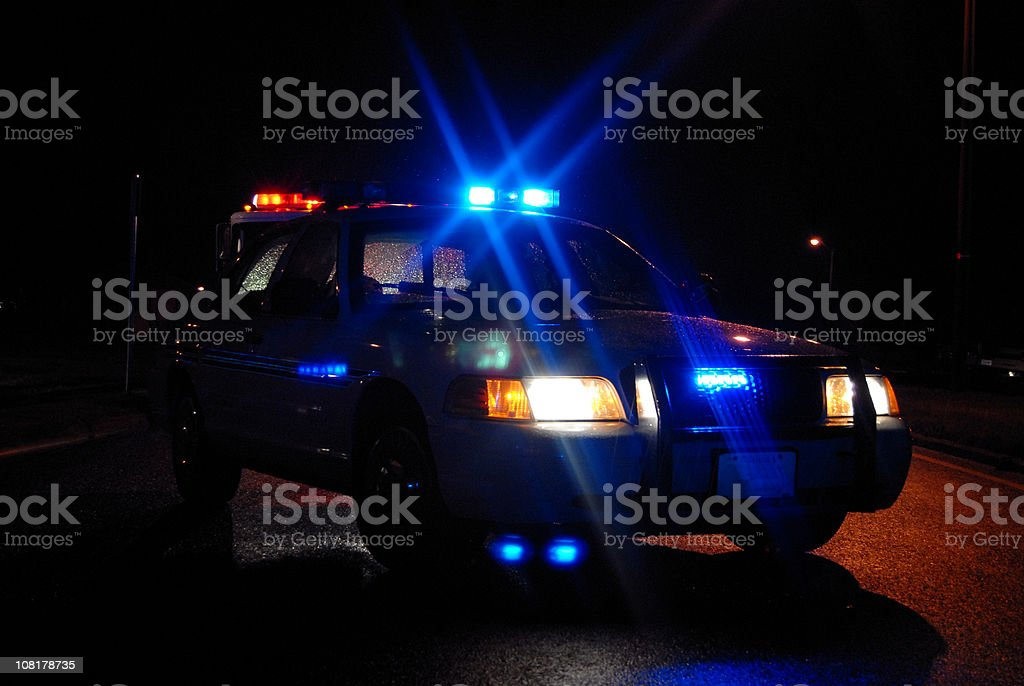Police Car at Night with Lights On stock photo