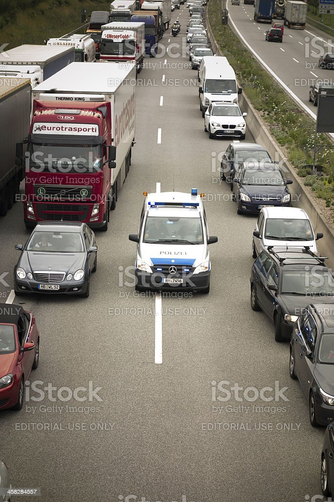 Police car at rush hour on highway stock photo
