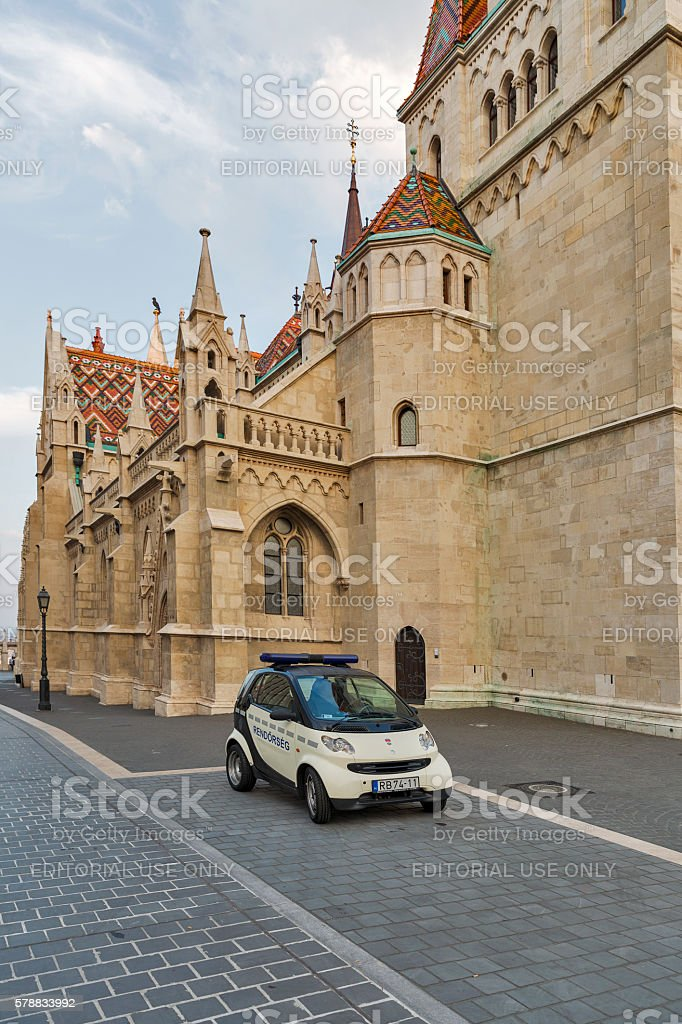 Police car in front of Matthias church. Budapest, Hungary. stock photo