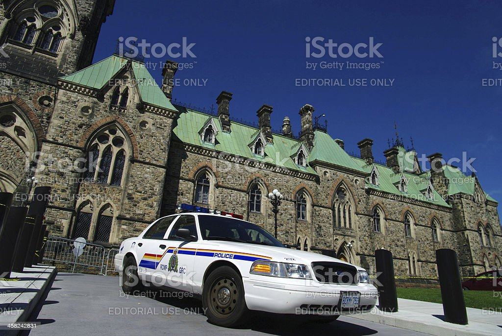 Police car in front of the government building stock photo