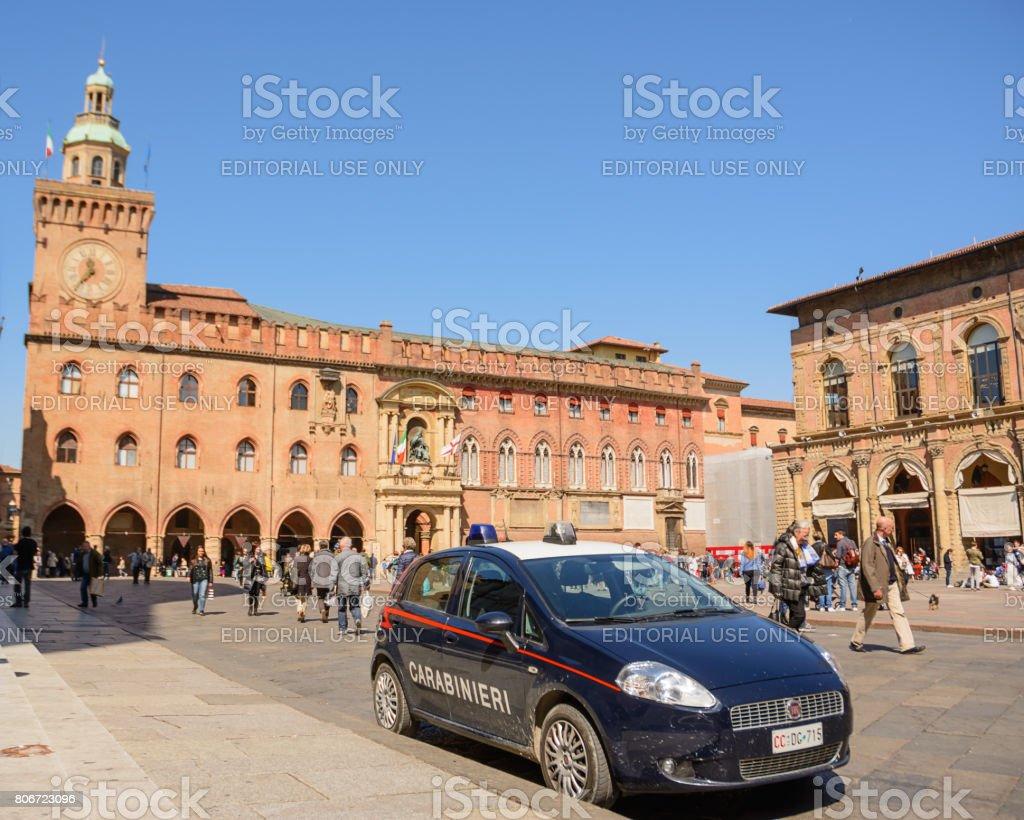 Police car in Piazza Maggiore of Bologna with tourists stock photo