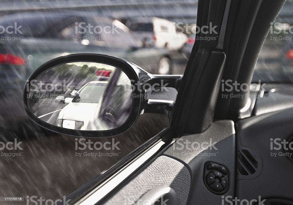 police car in rearview mirror stock photo