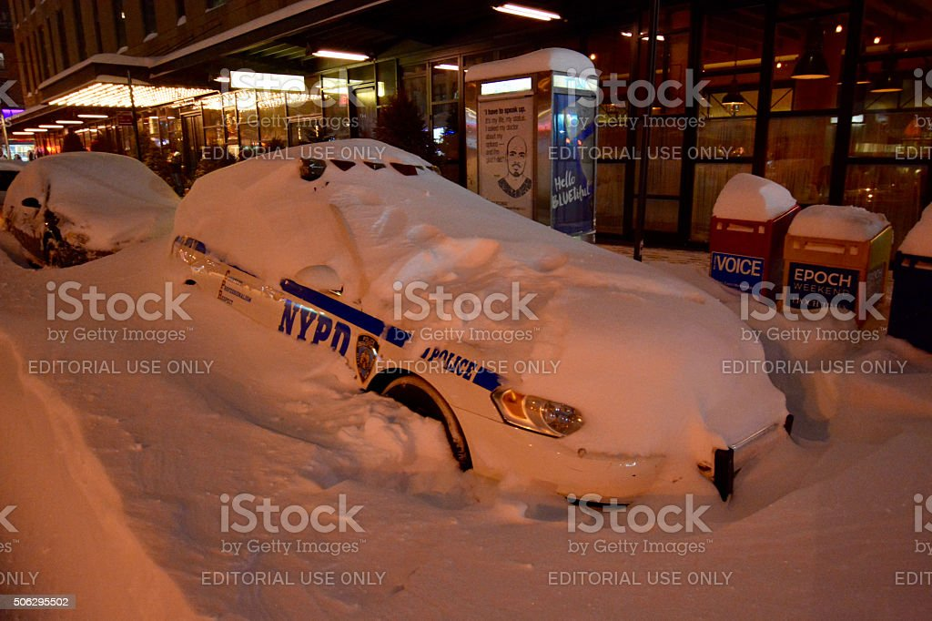 NYPD police car in snow blizzard in new york stock photo