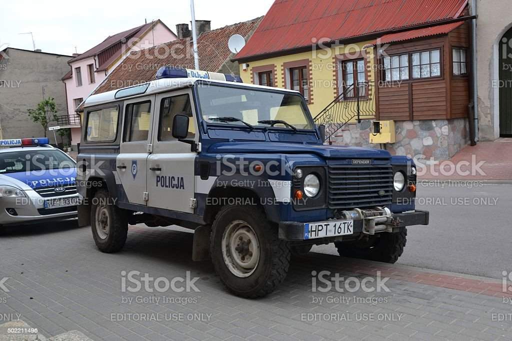Police car Land Rover Defender on the street stock photo