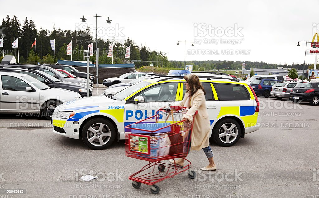 Police car on a parking space outside shopping center stock photo