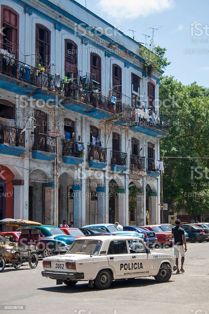 Police Car Outside Havana Apartment Building stock photo