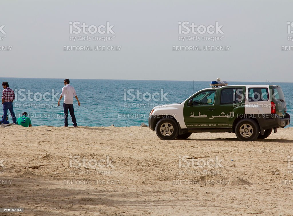 Police car (SUV) parked at the Jumeirah beach stock photo