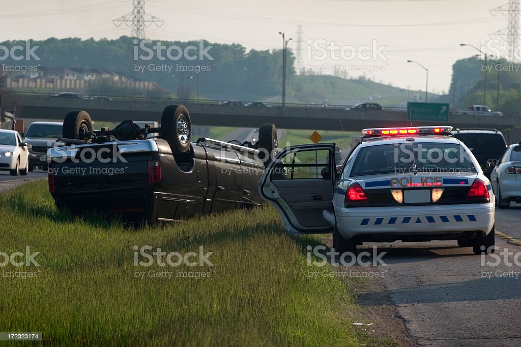 Police car parked by truck accident crash stock photo