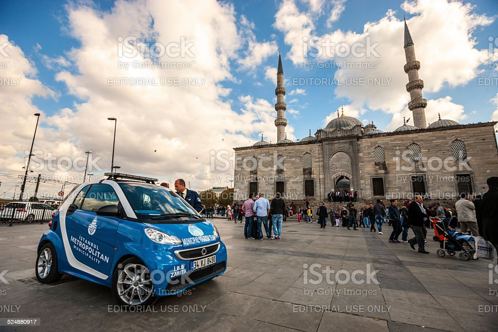 Police car parked in front of Yeni Camii Mosque, Istanbul stock photo
