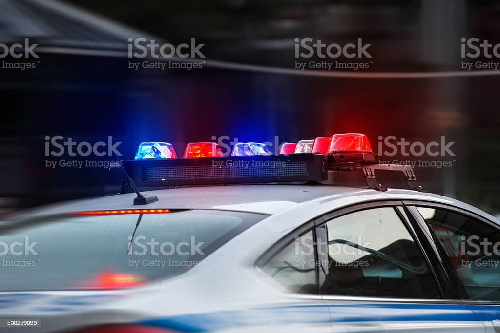 police car rushes to the emergency call with lights turned stock photo