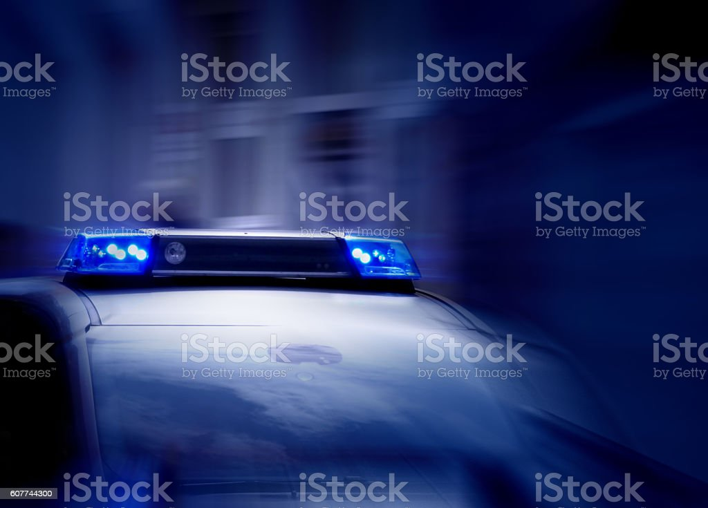 police car with blue lights switched on stock photo