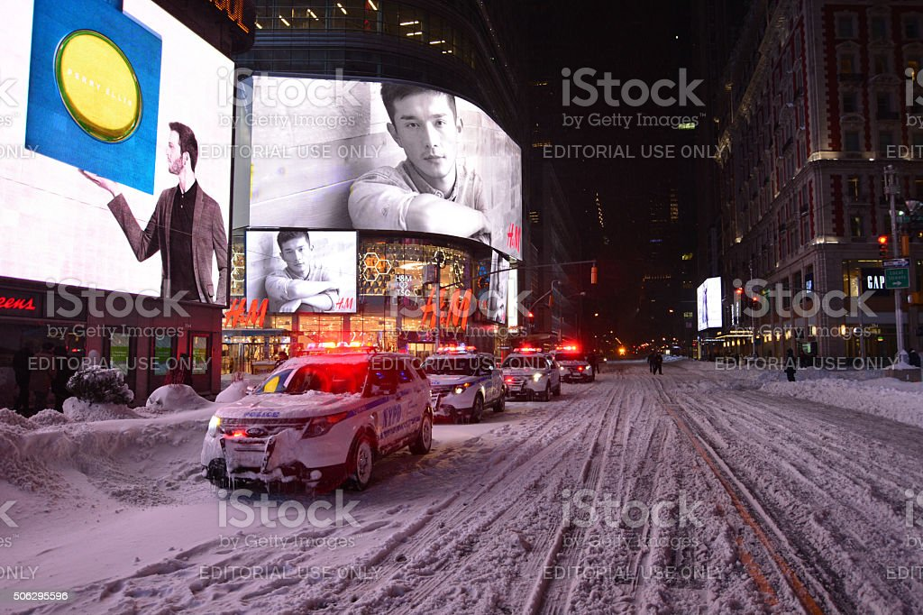 NYPD police cars in snow blizzard in new york stock photo