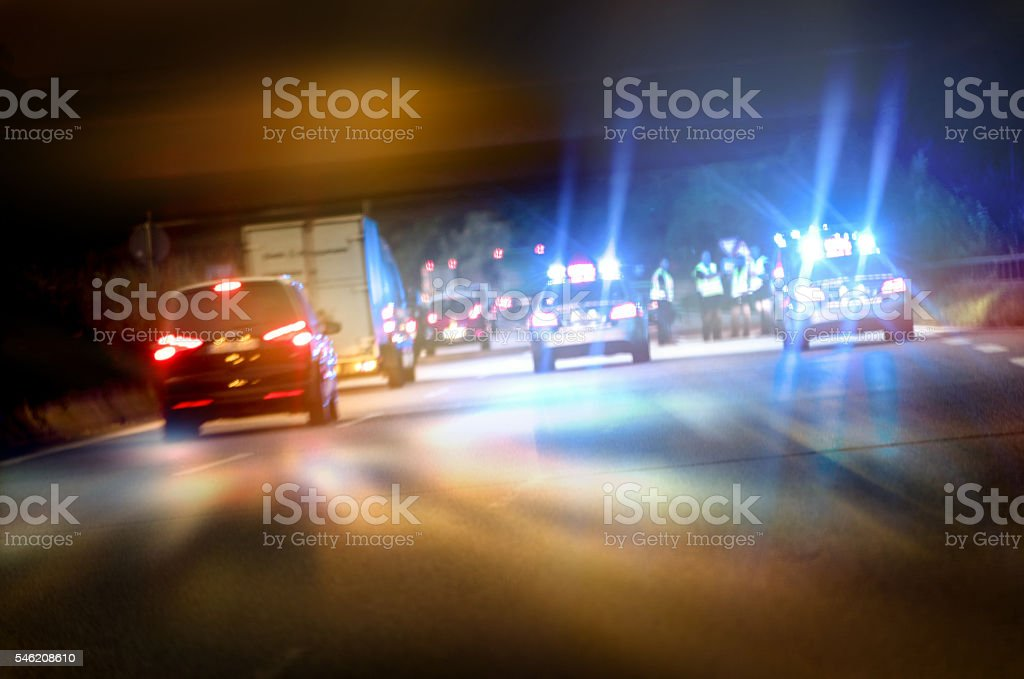 Police cars on highway at night stock photo