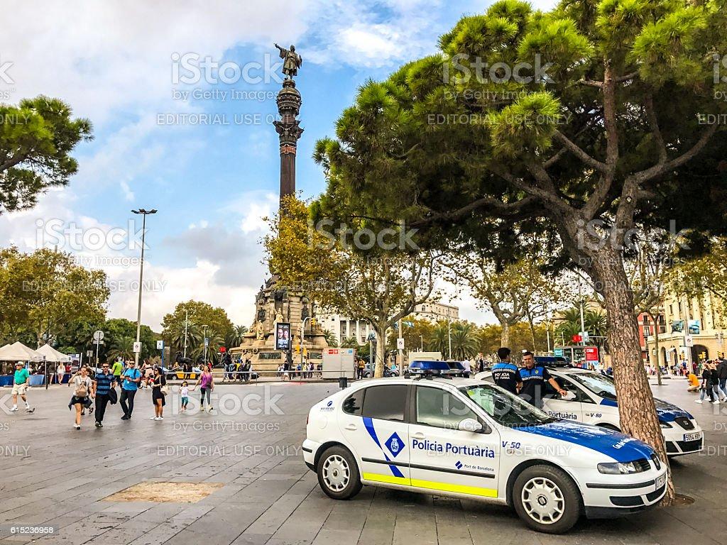 Police cars parked near Columbus monument, Barcelona stock photo