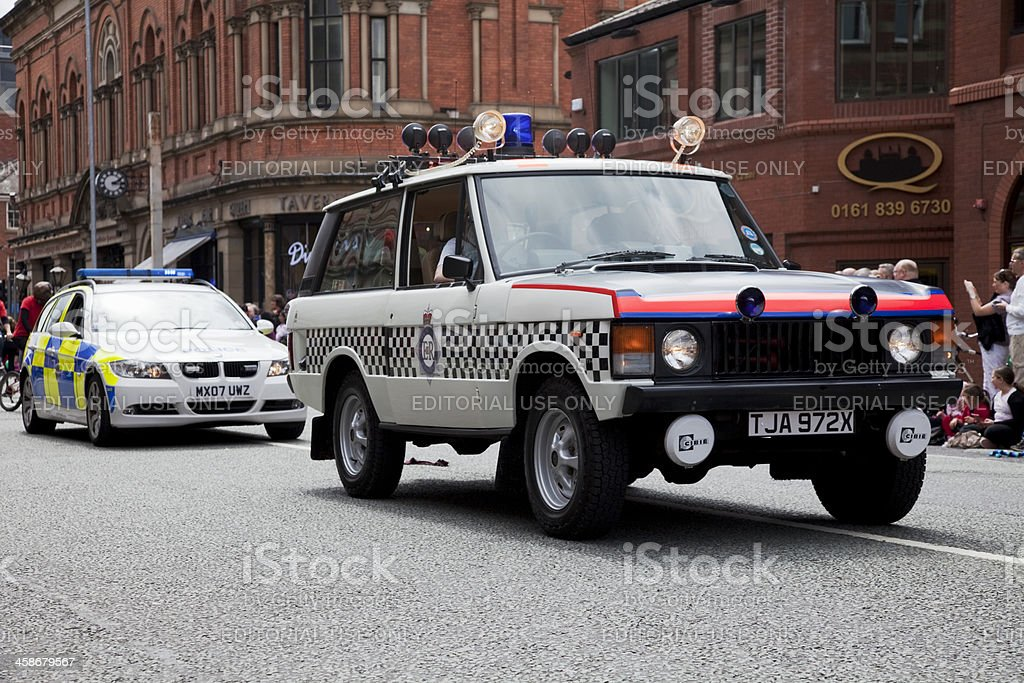 Police cars, Range Rover and BMW 3 Series stock photo
