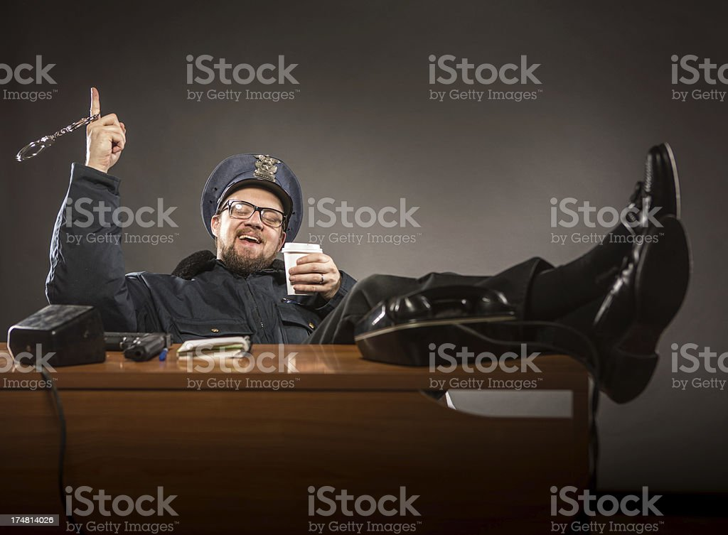 Police Chief enjoying a Coffee Break royalty-free stock photo