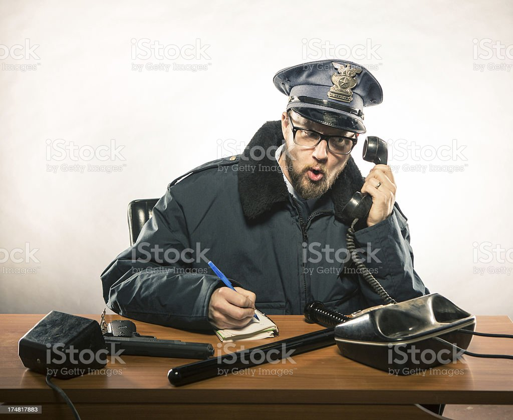 Police Chief on the Phone at his Desk royalty-free stock photo