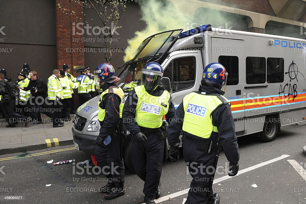 Police Come Under Attack During an Austerity Rally in London stock photo